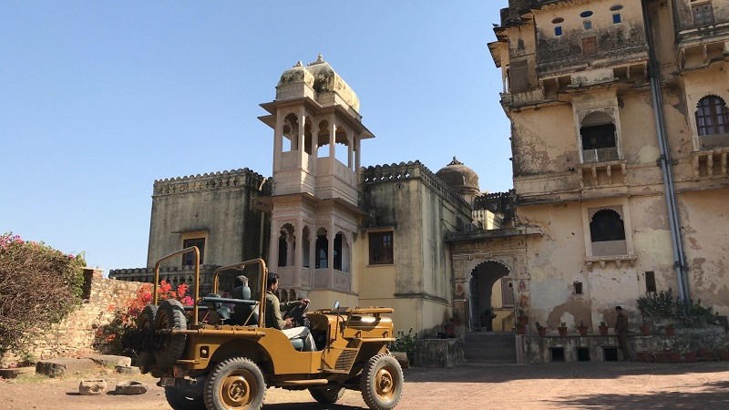 Rajasthan Fort Bhainsrorgarh drone photo of allan blanchard arriving by old style open jeep