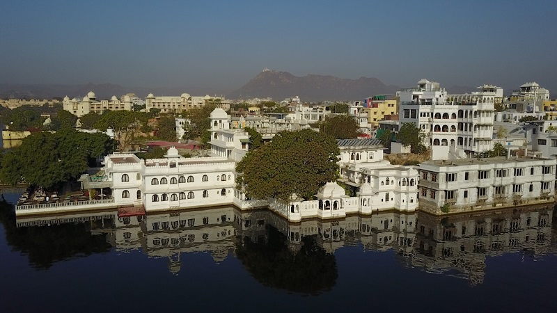 Udaipur Hotel Amet Haveli drone photo of the hotel lake pichola and monsoon palace