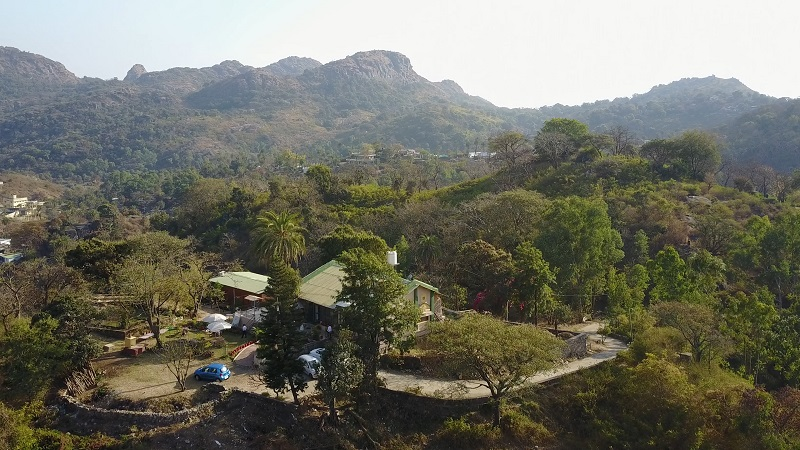 Forest Eco Lodge Mount Abu Rajasthan drone photo of homestay and  mountains