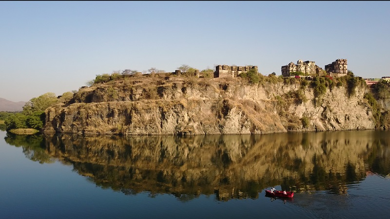 Rajasthan Fort Bhainsrorgarh drone ariel photo of entire fort reflection in chambal river boat safari